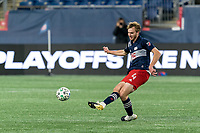 FOXBOROUGH, MA - NOVEMBER 20: Henry Kessler #4 of New England Revolution passes the ball during the Audi 2020 MLS Cup Playoffs, Eastern Conference Play-In Round game between Montreal Impact and New England Revolution at Gillette Stadium on November 20, 2020 in Foxborough, Massachusetts.