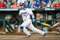 Florida Gators catcher Mike Rivera (4) follows through on his swing against the Miami Hurricanes in the NCAA College World Series on June 13, 2015 at TD Ameritrade Park in Omaha, Nebraska. Florida defeated Miami 15-3. (Andrew Woolley/Four Seam Images)