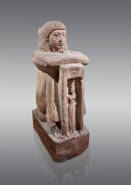 """Ancient Egyptian statue of Qen, priest of Anukis, sanstone, New Kingdom, 19th Dynasty, (1292-1191 BC), Isalnd of sehel. Egyptian Museum, Turin. Grey background.<br /> <br /> Qen was a """"gods father of Amon of Elephantine and of Khnum, Satis and Anukis"""". Elephantine is a Greek name of the present day Aswan. The naos, shrine, contains a female wearing a high plumed headdress. She is Anukis goddess of the Nile flood. With the ram-heahed god Khum and the goddess Satis, she formed the triad of the Elephantine. The statue probably comes from the temple of the Triad on Sehel Island just south of Elephantine.. Drovetti collection. Cat 3016."""