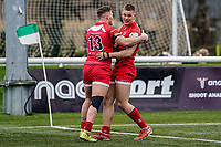 Alex Morgan of Jersey Reds (right) celebrates with George Spencer of Jersey Reds (left) after he scores his team's first try during the Championship Cup QF match between Ealing Trailfinders and Jersey Reds at Castle Bar, West Ealing, England  on 22 February 2020. Photo by David Horn.