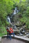 Ireland, County Kerry, near Killarney, Killarney National Park,Torc waterfall with couple in foreground   Irland, County Kerry, bei Killarney, Killarney National Park, Torc Wasserfall