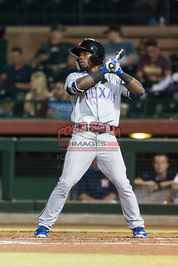 Surprise Saguaros left fielder Julio Pablo Martinez (40), of the Texas Rangers organization, at bat during an Arizona Fall League game against the Scottsdale Scorpions at Scottsdale Stadium on October 15, 2018 in Scottsdale, Arizona. Surprise defeated Scottsdale 2-0. (Zachary Lucy/Four Seam Images)