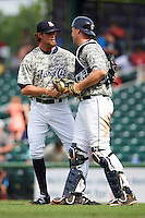 New Hampshire Fisher Cats relief pitcher Wil Browning (27) shakes hands with catcher Ryan Lavarnway (31) after a game against the Reading Fightin Phils on May 30, 2016 at Northeast Delta Dental Stadium in Manchester, New Hampshire.  New Hampshire defeated Reading 9-1.  (Mike Janes/Four Seam Images)