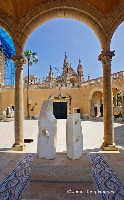 A black marble sculpture by the English artist Henry Moore stands on a covered terrace of the Palau March (March Palace) museum in Palma de Mallorca where the March Foundation's collection of modern sculpture can be seen. The Palace overlooks the city of Palma.