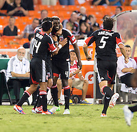 Brandon McDonald (4) of D.C. United celebrates his goal with teammates at RFK Stadium in Washington, DC.  D.C. United defeated the Chicago Fire, 4-2.