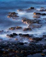 Low tide and lava rocks at sunrise. Kauai, Hawaii
