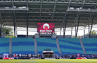 16th May 2020, Red Bull Arena, Leipzig, Germany; Bundesliga football, Leipzig versus FC Freiburg; A large Advertisement board enforces the Wearing of masks in front of an empty stadium