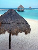 Mexico, Quintana Roo, Yucatan Peninsula, Akumal Mayan Riviera, palapas on beach by the sea