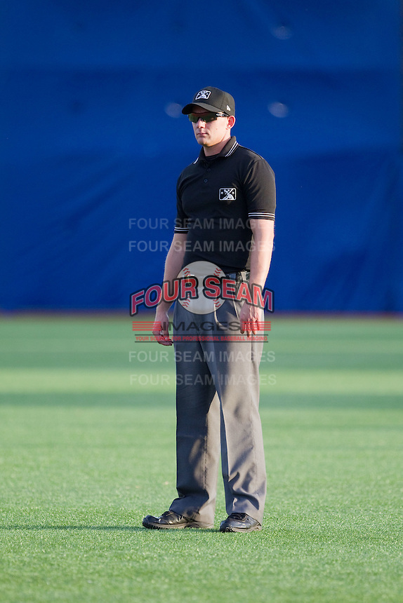 Field umpire Joe Schwartz during a game between the Hillsboro Hops and Tri-City Dust Devils at Ron Tonkin Field in Hillsboro, Oregon on August 24, 2015.  Tri-City defeated Hillsboro 5-1. (Ronnie Allen/Four Seam Images)