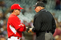 Houston Cougars head coach Todd Whitting #9 discusses a call with home plate umpire Greg Oros during the game against the Texas A&M Aggies at Minute Maid Park on March 6, 2011 in Houston, Texas.  Photo by Brian Westerholt / Four Seam Images