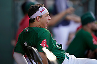 Second baseman Nick Yorke (4) of the Greenville Drive reacts to a teammate's home run in a game against the Hickory Crawdads on Sunday, August 29, 2021, at Fluor Field at the West End in Greenville, South Carolina. (Tom Priddy/Four Seam Images)