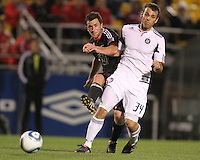 Stephen King#7 of D.C. United shoots the ball past Mike Videira#34 of the Chicago Fire during a second round match of the Carolina Challenge on March 9 2011 at Blackbaud Stadium, in Charleston, South Carolina. D.C. United won 1-0.