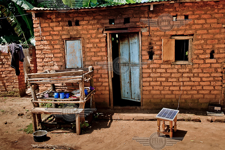 A solar panel for a phone charger Joshua Matagala uses to charge phones for customers in order to get an income.