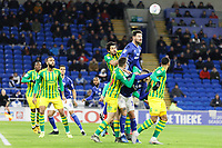 Sean Morrison of Cardiff City (TOP) jumps to head the ball during the Sky Bet Championship match between Cardiff City and West Bromwich Albion at the Cardiff City Stadium, Cardiff, Wales, UK. Tuesday 28 January 2020