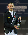 Marco Kutscher riding Van Gogh, Kevin Staut riding For Joy van't Zorgvliet HDC and Emanuele Gaudiano riding Caspar 232 celebrate at the podium after Kutscher,s victory  at the Longines Grand Prix, part of the Longines Masters of Hong Kong on 21 February 2016 at the Asia World Expo in Hong Kong, China. Photo by Juan Manuel Serrano / Power Sport Images
