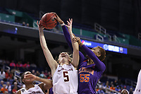 GREENSBORO, NC - MARCH 6: Georgia Pineau #5 of Boston College has her shot blocked by Tylar Bennett #55 of Clemson University during a game between Clemson and Boston College at Greensboro Coliseum on March 6, 2020 in Greensboro, North Carolina.