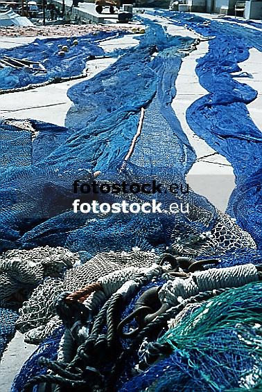 blue fishing nets drying in the sun<br />