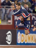 Clint Dempsey (NE Revolution, blue) takes a shot while in the air. NE Revolution defeat Columbus Crew, 1-0, at Gillette Stadium and secure home field advantage in the Eastern Conference Semifinal Series on October 14, 2006.