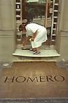 Buenos Aires Argentina South America Domestic staff, woman cleaning house apartment front door step. 2000 2000s