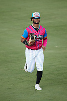 Pescados de Carolina center fielder Hedbert Perez (6) jogs off the field between innings of the game against the Delmarva Shorebirds at Five County Stadium on September 4, 2021 in Zebulon, North Carolina. (Brian Westerholt/Four Seam Images)