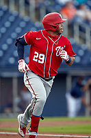 Washington Nationals Yadiel Hernandez (29) runs to first base during a Major League Spring Training game against the Houston Astros on March 19, 2021 at The Ballpark of the Palm Beaches in Palm Beach, Florida.  (Mike Janes/Four Seam Images)