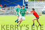 Adrian O'Connor Glenbeigh/Glencar and Pa Wrenn Milltown/Castlemaine  in action during their IFC clash in Killorglin on Sunday