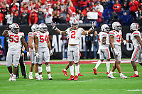 ndianapolis, IN - DEC 7, 2019: Ohio State Buckeyes defensive end Chase Young (2) gets the crowd hyped during a key third down at the Big Ten Championship game between Wisconsin and Ohio State at Lucas Oil Stadium in Indianapolis, IN. Ohio State came back from a 21-7 deficit at halftime to beat Wisconsin 34-21 to win its third straight Big Ten Championship. (Photo by Phillip Peters/Media Images International)