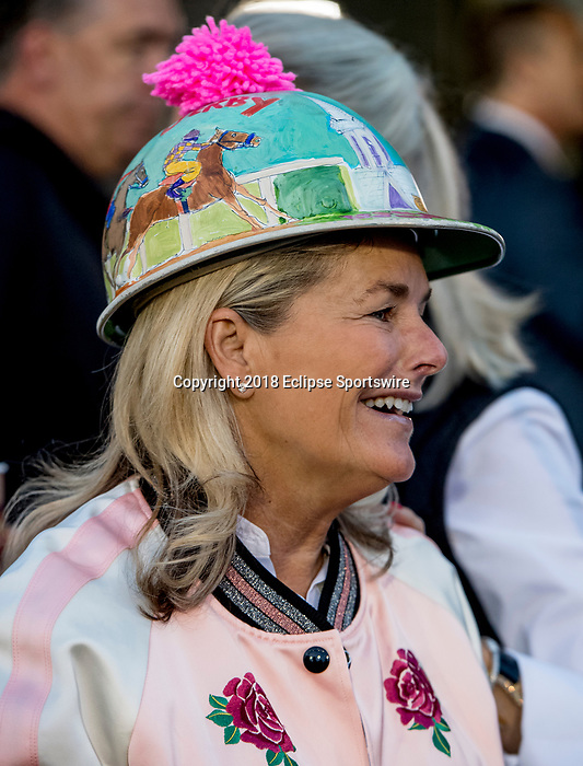 LOUISVILLE, KY - MAY 02: A fan wears a Derby helmet as she watches morning workouts at Churchill Downs on May 2, 2018 in Louisville, Kentucky. (Photo by Scott Serio/Eclipse Sportswire/Getty Images)