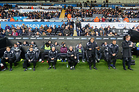 (L-R) The Swansea bench Dr. Jez McCluskey, Club Doctor, Physiotherapist, Ritson Lloyd, Adrian Tucker, goalkeeping coach, Alan Curtis, assistant coach, Bjorn Hamberg, assistant coach, Billy Reid, assistant manager and Graham Potter, manager for Swansea City during the Sky Bet Championship match between Swansea City and Wigan Athletic at the Liberty Stadium, Swansea, Wales, UK. Saturday 29 December 2018
