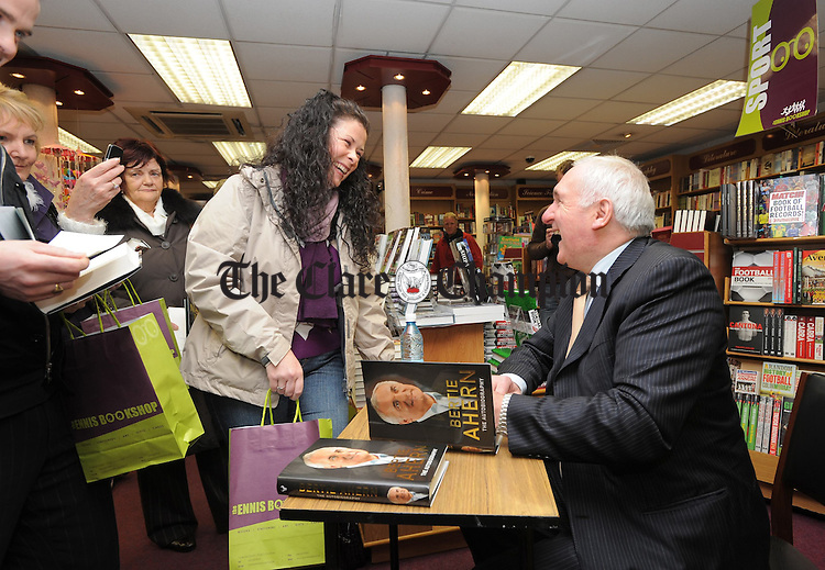 Former Taoiseach Bertie Ahern signing copies of his book at the Ennis Bookshop. Photograph by John Kelly.