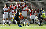 The Hamilton wall tries to stop a Barrie McKay free-kick