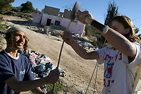 Young right-wing Jewish settlers establish themselves in an abandoned Arab house as they build in the outpost  Shvut Ami January 15, 2008, near the Israeli settlement Qedumim in the West Bank. The construction occupied by the settlers is property of a Palestinian woman from the Palestinian village of Kadum. Photo for the Chicago Tribune by Quique Kierszenbaum
