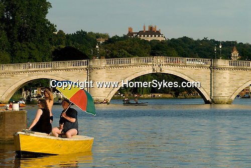 Richmond Upon Thames, Surrey, England 2007. Richmond bridge. Rowing boat messing about on the river.