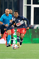 FOXBOROUGH, MA - MAY 16: Wilfrid Katoum #5 of New England Revolution passes the ball during a game between Columbus SC and New England Revolution at Gillette Stadium on May 16, 2021 in Foxborough, Massachusetts.