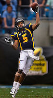 West Virginia quarterback Pat White (5) throws a pass against North Carolina during the Meineke Car Care Bowl college football game at Bank of America Stadium in Charlotte, NC.