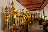 Bangkok, Thailand.  Buddhas in the Cloister (Phra Rabiang) Surrounding the Chedis of the first Four Rama Kings, Wat Pho Temple Compound.