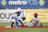 Shortstop Arismendy Alcantara #3 of the Daytona Cubs attempts to tag out Albert Cartwright #8 of the Clearwater Threshers during the game at Jackie Robinson Ballpark on May 3, 2012 in Daytona Beach, Florida. (Scott Jontes/Four Seam Images)