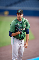 Clinton LumberKings pitcher Danny Garcia (14) warms up before a game against the West Michigan Whitecaps on May 3, 2017 at Fifth Third Ballpark in Comstock Park, Michigan.  West Michigan defeated Clinton 3-2.  (Mike Janes/Four Seam Images)
