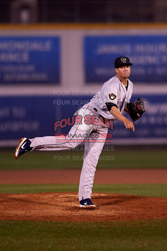 Wisconsin Timber Rattlers relief pitcher Yohandry Perez (37) during a Midwest League game against the Lansing Lugnuts at Cooley Law School Stadium on May 2, 2019 in Lansing, Michigan. Lansing defeated Wisconsin 10-4. (Zachary Lucy/Four Seam Images)