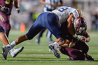 Texas State quarterback Tyler Jones (2) is sacked by Navy linebacker Daniel Gonzales (58) during second half of NCAA Football game, Saturday, September 13, 2014 in San Marcos, Tex. Navy defeated Texas State 35-21.(Mo Khursheed/TFV Media via AP Images)<br /> <br /> ***CAPTION CORRECTION***<br /> Correct name of the Navy player is line backer Daniel Gonzales (58) not outside linebacker Josiah Powell (48).