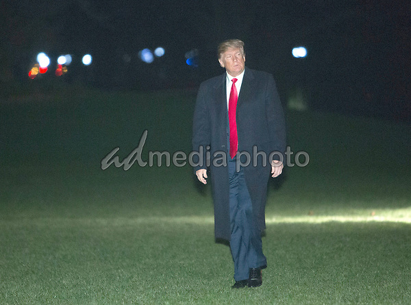 United States President Donald J. Trump returns to the White House in Washington, DC, after attending a political rally in Moon Township, Pennsylvania, March 10, 2018. Photo Credit: Chris Kleponis/CNP/AdMedia