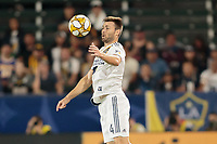 CARSON, CA - SEPTEMBER 15: Dave Romney #4 of the Los Angeles Galaxy traps a ball during a game between Sporting Kansas City and Los Angeles Galaxy at Dignity Health Sports Complex on September 15, 2019 in Carson, California.