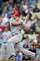 Cincinnati Reds third baseman Scott Rolen #27 bats against the Los Angeles Dodgers at Dodger Stadium on June 14, 2011 in Los Angeles,California. (Larry Goren/Four Seam Images)