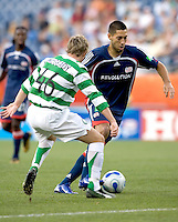 Clint Dempsey (Revolution, blue) dribbles past  Aiden McGeady (Celtic, green/white). The New England Revolution tie to Celtic FC, 1-1, July 19 at Gillette Stadium.