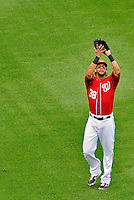 25 September 2011: Washington Nationals outfielder Michael Morse pulls in a fly during a game against the Atlanta Braves at Nationals Park in Washington, DC. The Nationals shut out the Braves 3-0 to take the rubber match third game of their 3-game series - the Nationals' final home game for the 2011 season. Mandatory Credit: Ed Wolfstein Photo
