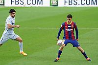 19th December 2020; Camp Nou, Barcelona, Catalonia, Spain; La Liga Football, Barcelona versus Valencia;  Pedri controls the ball as Goncalo Guedes of Valencia comes in to challenge