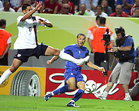 Clint Dempsey of the USA flies in too late to stop a cross from Fabio Cannavaro of Italy. The USA and Italy played to a 1-1 tie in their FIFA World Cup Group E match at Fritz-Walter-Stadion, Kaiserslautern, Germany, June 17, 2006.