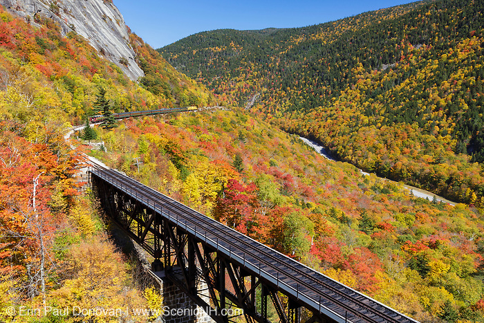 """Conway Scenic Railroad's """"Notch Train"""" along the old Maine Central Railroad in Hart's Location, New Hampshire during the autumn months. This trestle is within Crawford Notch State Park. And since 1995 the Conway Scenic Railroad, which provides passenger excursion trains has been using the track."""