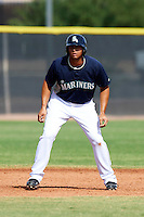 Seattle Mariners minor league infielder Kristian Brito #8 during an instructional league game against the San Diego Padres at the Peoria Sports Complex on October 6, 2012 in Peoria, Arizona.  (Mike Janes/Four Seam Images)