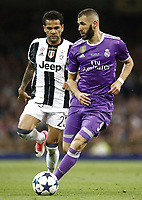 Calcio, Champions League: finale Juventus vs Real Madrid. Cardiff, Millennium Stadium, 3 giugno 2017.<br /> Real Madrid's Karim Benzema (r) in action with Juventus' Dani Alves (l) during the Champions League final match between Juventus and Real Madrid at Cardiff's Millennium Stadium, Wales, June 3, 2017. Real Madrid won 4-1.<br /> UPDATE IMAGES PRESS/Isabella Bonotto